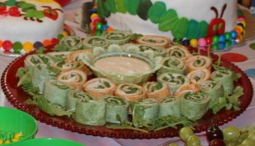 Very Hungry Caterpillar birthday party food ideas turkey and cheese wraps with green and red shells to match the caterpillar colors 500x286 The Very Hungry Caterpillar Birthday Bash Food!