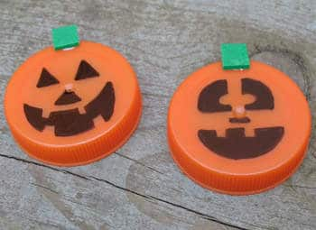 plastic lid pumpkins halloween craft photo 350x255 aformaro 330 rdax 65 31 Days of Halloween: 10 Crafts to Do with Your Kids