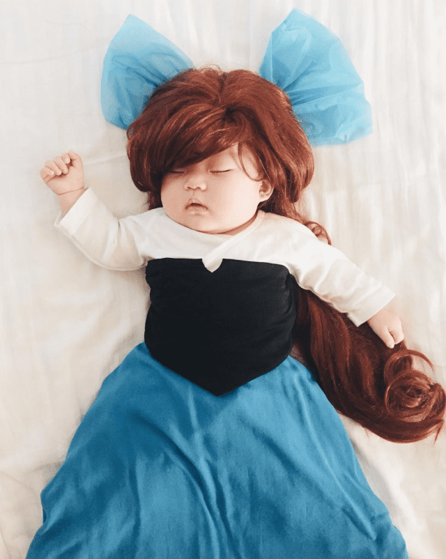 mom-dresses-up-her-baby-in-adorable-costumes-while-she-naps-little-mermaid